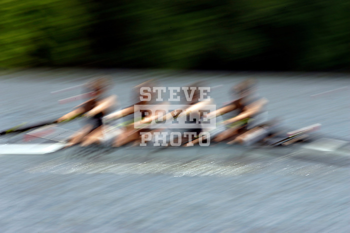 A four woman crew rows down the river as they compete during the 68th Dad Vail Regatta on the Schuylkill River in Philadelphia, Pennsylvania on May 12, 2006..