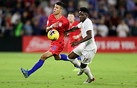 ORLANDO, FL - NOVEMBER 15: Alfredo Morales #15 of the United States battles Alphonso Davies #12 of Canada for a ball during a game between Canada and USMNT at Exploria Stadium on November 15, 2019 in Orlando, Florida.