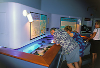 The Maui Ocean Center is unique attraction where visitors can see and feel Hawaii's marine life up close. In this image visitors discover information about a corals lifecycle.