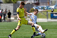 Reid Drake of Eastern Suburbs competes for the ball with Adam Hillis of the Wellington Phoenix during the ISPS Handa Men's Premiership - Wellington Phoenix v Eastern Suburbs at Fraser Park, Wellington on Saturday 28 November 2020.<br /> Copyright photo: Masanori Udagawa /  www.photosport.nz