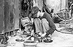 Local man at a repair stop on the streets of Danang, Vietnam