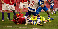 2nd April 2021, Oakwell Stadium, Barnsley, Yorkshire, England; English Football League Championship Football, Barnsley FC versus Reading; Rafael of Reading watches the ball through the legs of Andy Rinomhota of Reading as Callum Styles of Barnsley is on the ground in a goalmouth melee