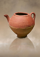 Assyrian Traders terra cotta imported teapot with side spout . 1900 - 1600 BC. Çorum Archaeological Museum, Corum, Turkey. Against a warm art bacground. Against a warm art bacground.
