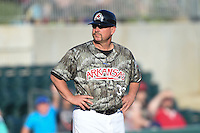 Arkansas Travelers manager Phillip Wellman (30) during a game against the San Antonio Missions on May 25, 2014 at Dickey-Stephens Park in Little Rock, Arkansas.  Arkansas defeated San Antonio 3-1.  (Mike Janes/Four Seam Images)