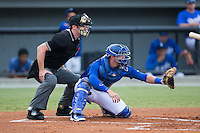 Burlington Royals catcher Colton Frabasilio (18) sets a target as home plate umpire Tom Hanahan looks on during the Appalachian League game against the Greeneville Astros at Burlington Athletic Park on August 29, 2015 in Burlington, North Carolina.  The Royals defeated the Astros 3-1. (Brian Westerholt/Four Seam Images)