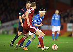 Aberdeen v St Johnstone...01.01.15   SPFL<br /> Steven MacLean is closed down by Mark Reynolds<br /> Picture by Graeme Hart.<br /> Copyright Perthshire Picture Agency<br /> Tel: 01738 623350  Mobile: 07990 594431