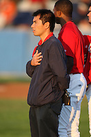 """September 5, 2009:  Trainer Manabu """"BU"""" Kuwarzuru of the Batavia Muckdogs stands during the National Anthem before a game at Dwyer Stadium in Batavia, NY.  The Muckdogs are the Short-Season Class-A affiliate of the St. Louis Cardinals.  Photo By Mike Janes/Four Seam Images"""