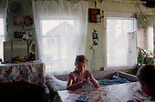 Lohoma, Russia<br /> July, 1998<br /> <br /> A child plays cards in a remote village in northern Russia.
