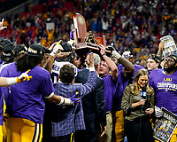 ATLANTA, GA - DECEMBER 7: head coach Ed Orgeron of the LSU Tigers lifts the SEC Championship trophy during a game between Georgia Bulldogs and LSU Tigers at Mercedes Benz Stadium on December 7, 2019 in Atlanta, Georgia.