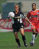 Heather Beam of the Power looks to control the ball as Thori Bryan trails. The San Jose CyberRays were defeated by the NY Power played 2-1 on 7/05/03 at Mitchel Athletic Complex, Uniondale, NY..