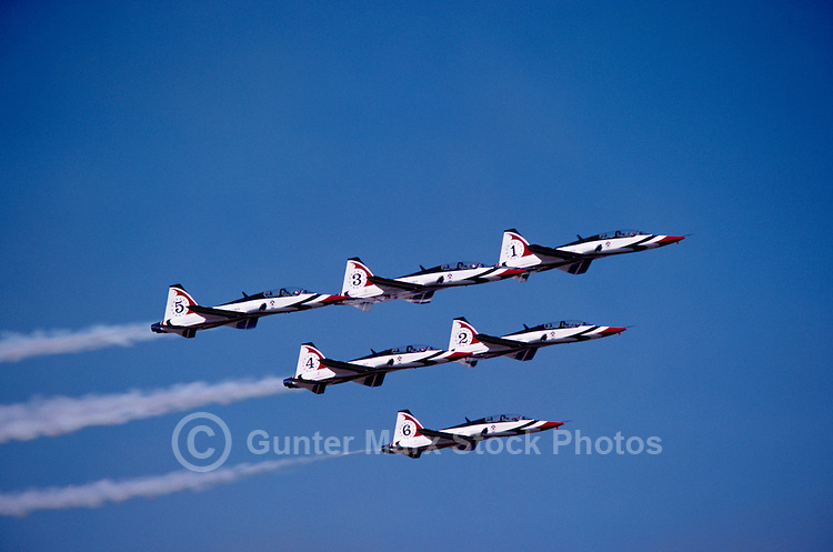 US Air Force Thunderbirds flying in Close Formation in Sky with Smoke - at Abbotsford International Airshow, BC, British Columbia, Canada