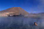 Atacama Desert Chile South America A tourist in one of the many hot pools created by geysers 2000s