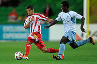 MELBOURNE, AUSTRALIA - FEBRUARY 12: Aziz Behich of the Heart protects the ball from Kofi Danning of Sydney FC in the round 27 A-League match between the Melbourne Heart and Sydney FC at AAMI Park on February 12, 2011 in Melbourne, Australia. (Photo Sydney Low / AsteriskImages.com)