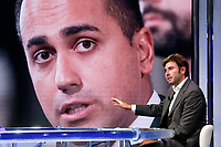 Former deputy of Movement 5 Stars and writer Alessandro Di Battista appears as a guest on the talk show Porta a Porta to present his new book 'Contro'. In the background, on the screen, Luigi Di Maio.<br /> Rome (Italy), May 25th 2021<br /> Photo Samantha Zucchi Insidefoto