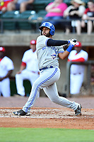 Bluefield Blue Jays catcher Andres Guerra (17) swings at a pitch during a game against the Greeneville Reds at Pioneer Park on June 30, 2018 in Greeneville, Tennessee. The Blue Jays defeated the Red 7-3. (Tony Farlow/Four Seam Images)
