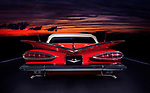 Red 1959 Chevrolet Impala Convertible classic retro car rear view on a highway in colorful red twilight nighttime outdoor scenery Image © MaximImages, License at https://www.maximimages.com