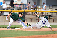 Clinton LumberKings third baseman Joseph DeCarlo (5) tags pinch runner Branden Cogswell (13), who was called out, sliding into third during a game against the Beloit Snappers on August 17, 2014 at Ashford University Field in Clinton, Iowa.  Clinton defeated Beloit 4-3.  (Mike Janes/Four Seam Images)