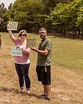 May 5, 2018. Fayetteville, North Carolina.<br /> <br /> Vanessa and Jon Hall hold signs about the GenX pollution of the Cape Fear River on Hwy. 87 just outside the Chemours plant which has been dumping GenX unregulated into the river for years. <br /> <br /> The Chemours Company, a spin off from DuPont, manufactures many chemicals at its plant in Fayetteville, NC. One of these, commonly referred to as GenX, is part of the process of teflon manufacturing. Chemours has been accused of dumping large quantities of GenX into the Cape Fear River and polluting the water supply of city's down river and allowing GenX to leak into local aquifers.