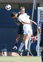 Alex Verdi #12 of Georgetown University heads away from Brent Rosendall #19 of Michigan State during an NCAA match at North Kehoe Field, Georgetown University on September 5 2010 in Washington D.C. Georgetown won 4-0.