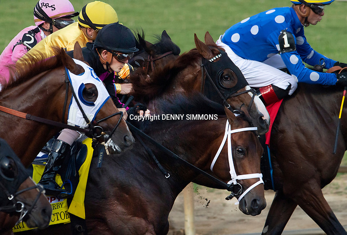 Art Collector, ridden by jockey Brian Hernandez Jr., in black helmet, breaks from the gate in the Runhappy Ellis Park Derby's 10th race for a $200,000 purse at Ellis Park in Henderson, Ky., Sunday afternoon, Aug. 9, 2020. Art Collector won the race handily. The race is a qualifier for the upcoming Sept. 5, 2020, Kentucky Derby, with 85 points (50-20-10-5) up for grabs.