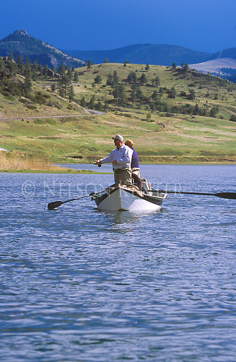 Fly fisherman in a drift boat on the Missouri River in Montana