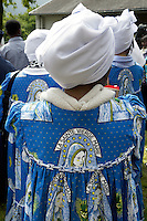 Switzerland. Canton Valais. St-Maurice. Africa Saints Pilgrimage (Pèlerinage aux Saints d'Afrique). A religious choir, originally from Cameroon, wearing a boubou with the drawing of the Virgin Mary prays and celebrates its faith and belief in Jesus  Christ. According to religious tradition, Mary was an Israelite Jewish woman and the mother of Jesus. Among her many other names and titles are the Virgin Mary or Blessed Virgin Mary, Mother of God, and Saint Mary in Western churches, Theotokos in Orthodox Christianity, and Maryam, mother of Isa in Islam. 2.06.13 © 2013 Didier Ruef