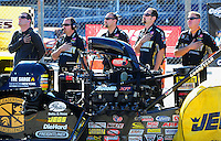 Oct. 30, 2011; Las Vegas, NV, USA: NHRA crew members for top fuel dragster driver Tony Schumacher during the Big O Tires Nationals at The Strip at Las Vegas Motor Speedway. Mandatory Credit: Mark J. Rebilas-