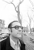Undated file photo File photo. Poet Gaston Miron pose near the hourse of Emile Nelligan in Saint-Louis Square, Montreal, Canada.<br /> <br /> Photo : AQP - Alain Renaud