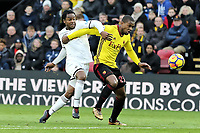 (L-R) Renato Sanches of Swansea City challenges Christian Kabasele of Watford during the Premier League match between Watford and Swansea City at the Vicarage Road, Watford, England, UK. Saturday 30 December 2017