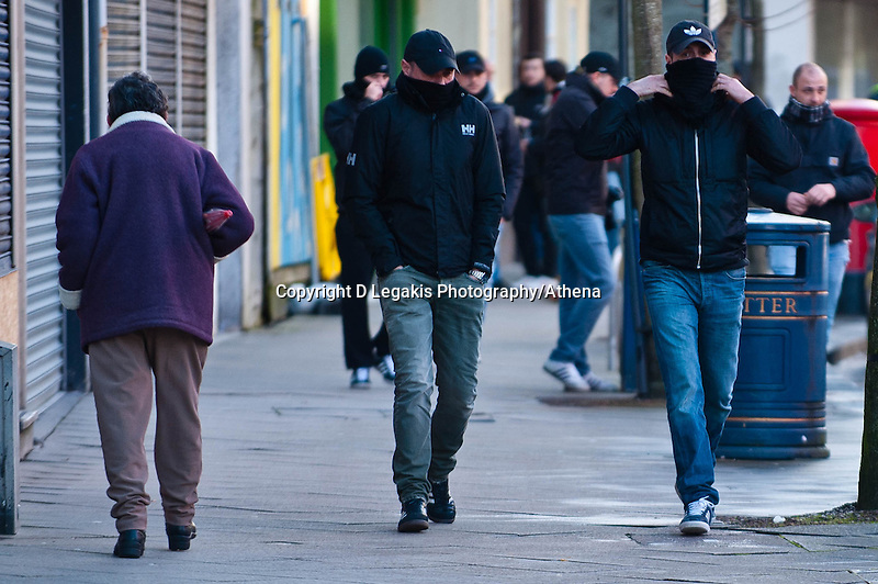 Thursday 20 February 2014<br /> Pictured: Napoli Supporters walk along  Swansea's High Street, many covering their faces<br /> Re: Napoli Supporters visit Swansea for tonights UEFA Leauge clash