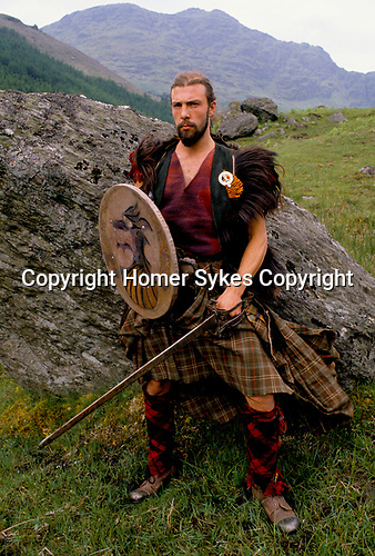 'CLAN, THE' SCOTLAND, A GROUP WHO SPEND THEIR WEEKENDS AT A CAMP IN GLEN CROE, RECREATING THE LIFE OF A SCOTTISH CLAN BEFORE THE DEFEAT OF BONNIE PRINCE CHARLIE BY THE ENGLISH AT THE BATTLE OF CULLODEN IN 1746. ONE OF THE CLAN'S MEMBERS, A GARDENER BY PROFESSION, 1989