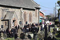 "Pictured: People attend the funeral at St Cadmarch's Church. Saturday 24 February 2018<br /> Re: The funeral of David Cuthbertson and his five children who died in a house fire in Llangammarch Wells, Powys, will take place at St Cadmarch's Church, on Saturday 24 February 2018.<br /> 68 year old David Cuthbertson, 68, died in the fire in October along with children Gypsy Grey Raine, 4, Patch Raine, 6, Misty Raine, 9, Reef Raine, 10, and Just Raine, 11.<br /> Three other children escaped the fire. The cause is being treated as unexplained.<br /> Dyfed Powys Police previously said an operation to dismantle about tonnes of bricks and mortar from the gutted house was being done ""brick by brick"" so that evidence is preserved."