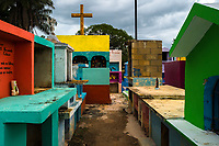 """Colorful niches and above-ground tombs are seen during the bone cleansing ritual at the cemetery in Pomuch, Mexico, 28 October 2019. Every year on the Day of the Dead, people of Pomuch, a small Mayan community in the south of Mexico, visit the cemetery to take part in a pre-Hispanic tradition of cleaning of bones of their departed relatives (""""Limpia de huesos""""). People who die in Pomuch are firstly buried for three years in an above-ground tomb then the dried-up bodies are taken out, bones are separated, wrapped in a decorated cloth, put into a wooden crate, and placed on display among flowers for veneration."""