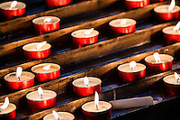 Devotional prayer candles in a Catholic church
