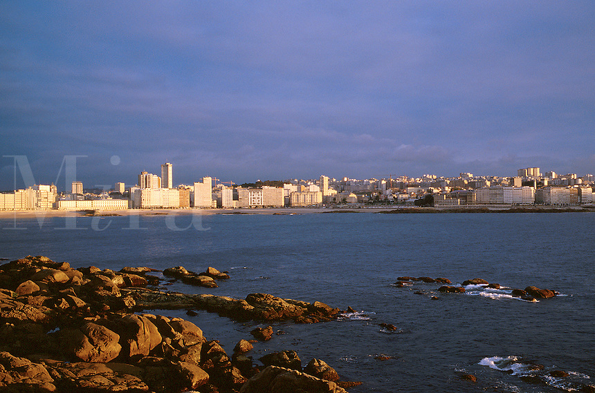 Spain, Galicia, La Coruna. Office buildings and hotels along Orzon beach.