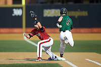Louisville Cardinals first baseman Logan Wyatt (43) reaches for a throw as Jake Mueller (6) of the Wake Forest Demon Deacons lunges for the bag at David F. Couch Ballpark on March 17, 2018 in  Winston-Salem, North Carolina.  The Cardinals defeated the Demon Deacons 11-6.  (Brian Westerholt/Four Seam Images)