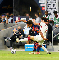 AUSTIN, TX - JULY 29: Nicholas Gioacchini #8 of the United States and Ahmed Alaa #7 of Qatar battle for control of the ball during a game between Qatar and USMNT at Q2 Stadium on July 29, 2021 in Austin, Texas.