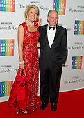Stephen A. Schwarzman, Chairman and CEO of the Blackstone Group, and his wife, Christine, arrive for the formal Artist's Dinner honoring the recipients of the 2014 Kennedy Center Honors hosted by United States Secretary of State John F. Kerry at the U.S. Department of State in Washington, D.C. on Saturday, December 6, 2014. The 2014 honorees are: singer Al Green, actor and filmmaker Tom Hanks, ballerina Patricia McBride, singer-songwriter Sting, and comedienne Lily Tomlin.<br /> Credit: Ron Sachs / Pool via CNP
