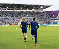 ORLANDO, FL - MARCH 05: Alyssa Naeher #1 and Adrianna Franch #21 of the United States warm up during a game between England and USWNT at Exploria Stadium on March 05, 2020 in Orlando, Florida.