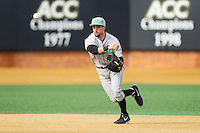 Marshall Thundering Herd shortstop Sergio Leon (4) makes a throw to first base against the Wake Forest Demon Deacons at Wake Forest Baseball Park on February 17, 2014 in Winston-Salem, North Carolina.  The Demon Deacons defeated the Thundering Herd 4-3.  (Brian Westerholt/Four Seam Images)