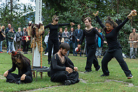 "Switzerland. Canton Ticino. Ascona. Monte Verità. Peace pole with the words: May peace prevail on earth. MOPS_DanceSyndrome. MOPS_DanceSyndrome is an independent Swiss artistic, cultural and social organisation operating in the field of contemporary dance and disability. It is composed only of Down dancers. Six dancers perform the ""Tritual"" show.. Left to right :  Elisabetta Montobbio, Gaia Mereu, Guglielmo Hug,  Amedea Aloisi, Simone Lunardi and Fatima Soumaré. Down syndrome (DS or DNS), also known as trisomy 21, is a genetic disorder caused by the presence of all or part of a third copy of chromosome 21 It is usually associated with physical growth delays, mild to moderate intellectual disability, and characteristic facial features. Monte Verità (literally, ""Mount Truth"") is a hill (350 meters) which has served as the site of many different Utopian and cultural events and communities since the beginning of the twentieth century. The Monte Verità hotel is also a well preserved testimony for the history of architecture (Bauhaus). 26.09.2020 © 2020 Didier Ruef"
