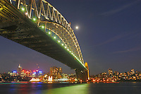Sydney Harbour Bridge with moon at night, Sydney, New South Wales, Australia