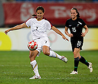 Shannon Boxx, Emma Kete. The USWNT defeated New Zealand, 4-0, during the 2008 Beijing Olympics in Shenyang, China.  With the win, the USWNT won group G and advanced to the semifinals.