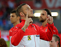 Marco Arnautovic of Austria points to the sky as he walks onto the pitch during the FIFA World Cup Qualifier Group D match between Wales and Austria at The Cardiff City Stadium, Cardiff, Wales, UK. Saturday 02 September 2017