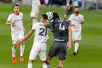 ST PAUL, MN - SEPTEMBER 06: Jose Aja #4 of Minnesota United FC and Tate Schmitt #21 of Real Salt Lake battle for the ball during a game between Real Salt Lake and Minnesota United FC at Allianz Field on September 06, 2020 in St Paul, Minnesota.