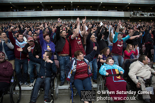 West Ham United 2 Crystal Palace 2, 02/04/2016. Boleyn Ground, Premier League. Home fans in the Betway Stand celebrating their team's second goal at the Boleyn Ground as West Ham United hosted Crystal Palace in a Barclays Premier League match. The Boleyn Ground at Upton Park was the club's home ground from 1904 until the end of the 2015-16 season when they moved into the Olympic Stadium, built for the 2012 London games, at nearby Stratford. The match ended in a 2-2 draw, watched by a near-capacity crowd of 34,857. Photo by Colin McPherson.