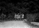 East McKeesport PA:  A view of Girl Scouts walking down a hiking trail at Camp Youghahela.