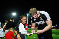 Photo: Richard Lane/Richard Lane Photography. London Wasps in Abu Dhabi for their LV= Cup game against Harlequins on 30st January 2011. 26/01/2011. Wasps' Bob Baker signs autographs after training at the Zyaid Sports City.