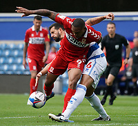 Middlesbrough's Britt Assombalonga is tackled by Queens Park Rangers' Yoann Barbet<br /> <br /> Photographer Stephanie Meek/CameraSport<br /> <br /> The EFL Sky Bet Championship - Queens Park Rangers v Middlesbrough - Saturday 26th September 2020 - Loftus Road - London <br /> <br /> World Copyright © 2020 CameraSport. All rights reserved. 43 Linden Ave. Countesthorpe. Leicester. England. LE8 5PG - Tel: +44 (0) 116 277 4147 - admin@camerasport.com - www.camerasport.com