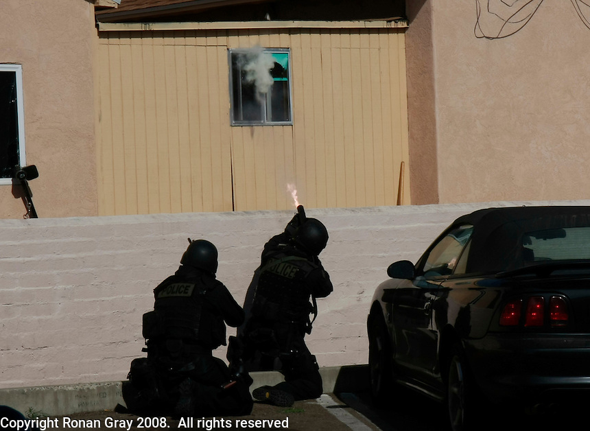 05-31-08: Pacific Beach, San Diego, CA.  A SWAT member fires his weapon into a house in Pacific Beach where suspect WalterCordell (52) is hiding.  Cordell beat his girlfriend Marlene Pernicano severly with a hammer the day before.